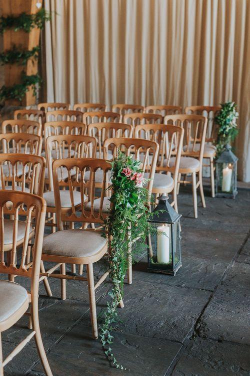 Flower & Foliage Aisle Chair Decor & Lanterns | Pink & Gold Summer Wedding at East Riddlesden Hall Barn, Wiltshire | Laura Calderwoods Photography