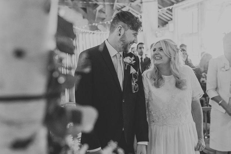 Wedding Ceremony | Bride in Custom Made Separates | Groom in Navy Next Suit & Pie Tie | Pink & Gold Summer Wedding at East Riddlesden Hall Barn, Wiltshire | Laura Calderwoods Photography