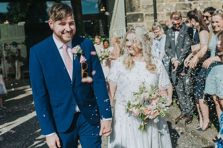 Confetti Moment | Bride in Custom Made Separates | Groom in Navy Next Suit & Pie Tie | Pink & Gold Summer Wedding at East Riddlesden Hall Barn, Wiltshire | Laura Calderwoods Photography