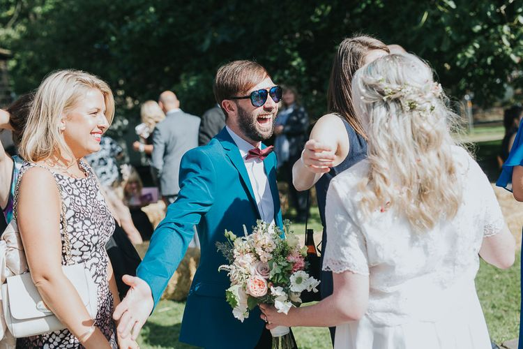 Wedding Guest Hugs | Bride in Custom Made Separates | Pink & Gold Summer Wedding at East Riddlesden Hall Barn, Wiltshire | Laura Calderwoods Photography
