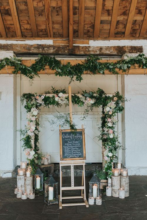 Floral Arch | Order of The Day Wedding Sign | Wedding Decor & Flowers | Pink & Gold Summer Wedding at East Riddlesden Hall Barn, Wiltshire | Laura Calderwoods Photography
