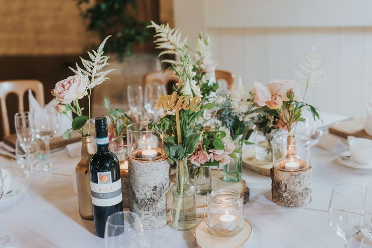 Tree Stumps, Candles & Flower Stems in Gold Spray Painted Bottles | Table Decor | Centrepiece | Pink & Gold Summer Wedding at East Riddlesden Hall Barn, Wiltshire | Laura Calderwoods Photography