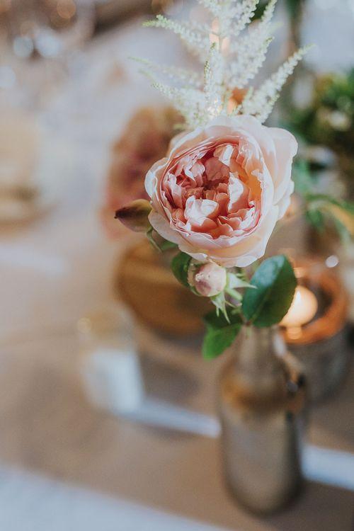 Pink Rose Flower Stem in Bottle | Pink & Gold Summer Wedding at East Riddlesden Hall Barn, Wiltshire | Laura Calderwoods Photography