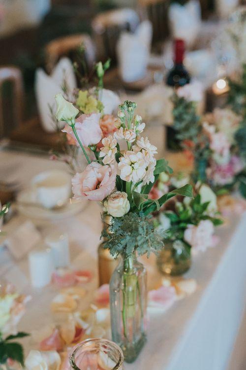 Pink Flower Stems in Bottles | Pink & Gold Summer Wedding at East Riddlesden Hall Barn, Wiltshire | Laura Calderwoods Photography