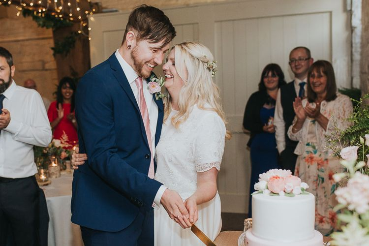Cutting The Cake | Bride in Custom Made Separates | Groom in Next Suit | Pink & Gold Summer Wedding at East Riddlesden Hall Barn, Wiltshire | Laura Calderwoods Photography