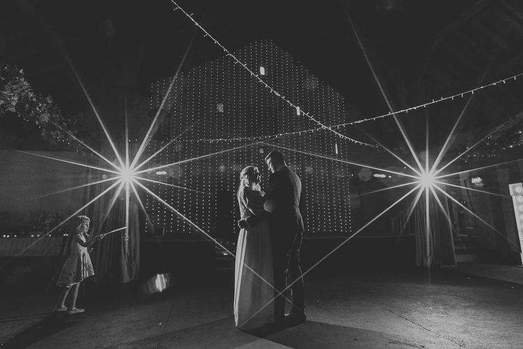 First Dance | Giant Light Up Letters | Fairy Lights | Portrait | Bride in Custom Made Separates | Groom in Next Suit | Pink & Gold Summer Wedding at East Riddlesden Hall Barn, Wiltshire | Laura Calderwoods Photography