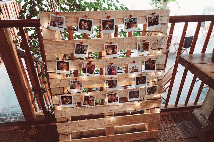 Polaroids On Wooden Palettes With Fairy Lights