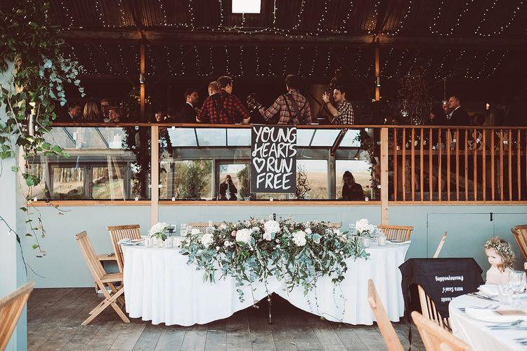 Top Table Floral Arrangement For Wedding