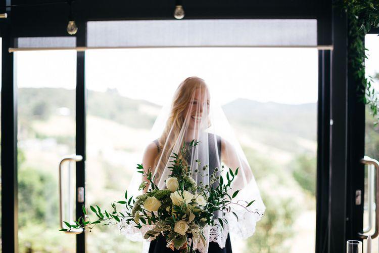 Bride in Navy Karen Walker Wedding Dress | White & Greenery Flower Arrangement | Mann House Venue | New Zealand Wedding | Nigel John Photography