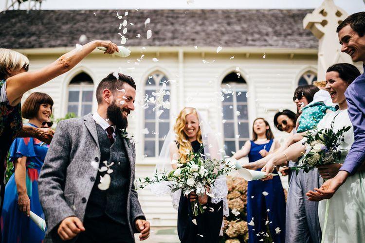 Confetti Moment | Bride in Navy Karen Walker Wedding Dress | Groom in Harris Tweed Suit | New Zealand Wedding | Nigel John Photography