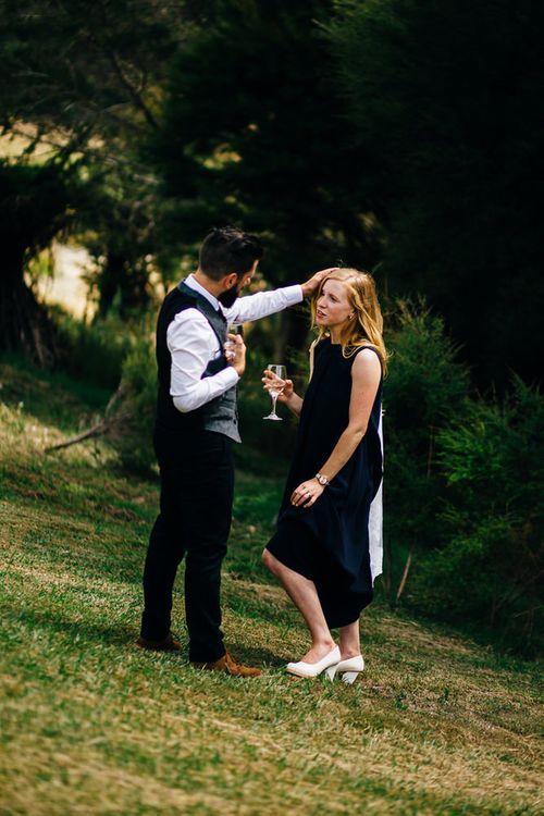 Bride in Navy Karen Walker Wedding Dress | Groom in Harris Tweed Suit | New Zealand Wedding | Nigel John Photography