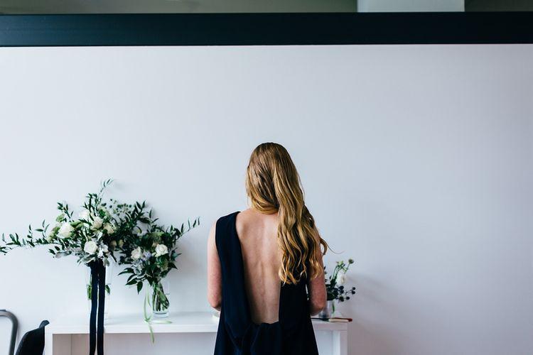 Navy Karen Walker Wedding Dress | White & Greenery Flower Arrangement | Mann House Venue | New Zealand Wedding | Nigel John Photography