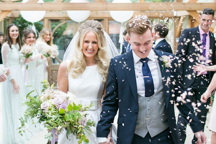 Confetti Moment | Bride in Sassi Holdford Bryony Wedding Dress | Pastel Wedding at Gaynes Park | Anneli Marinovich Photography