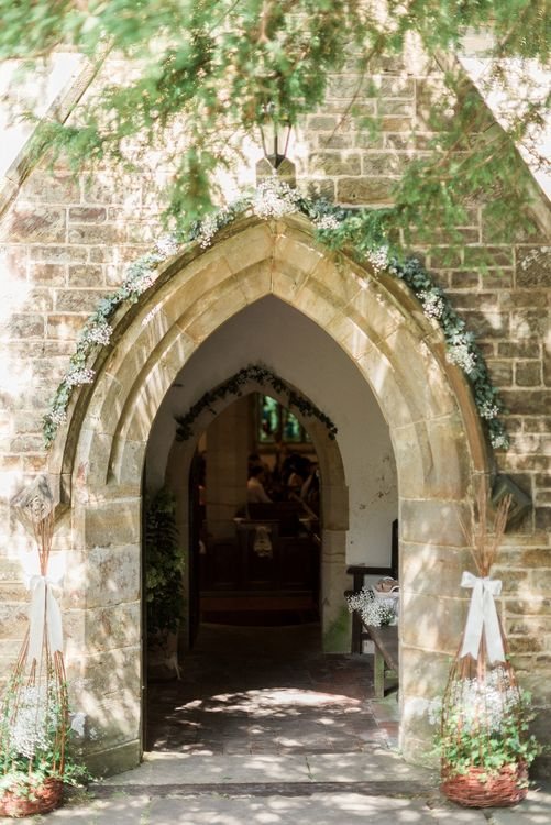 Archway Outside Church Floral Arch