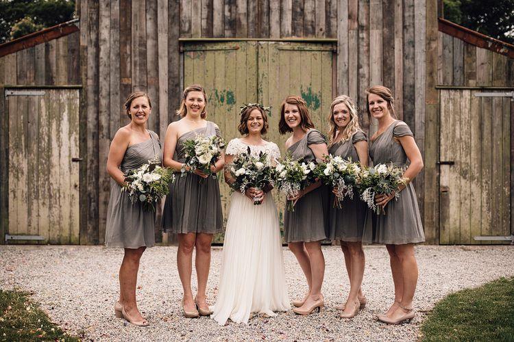 Bridesmaids in Grey One Shoulder JCrew Dresses | Bride in Catherine Deane Wedding Dress | Rustic Barn Wedding at Nancarrow Farm, Cornwall | Samuel Docker Photography
