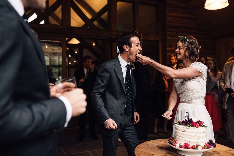 Cutting the Cake | Bride in Catherine Deane Gown | Groom in Grey Edit Suits Suit | Rustic Barn Wedding at Nancarrow Farm, Cornwall | Samuel Docker Photography