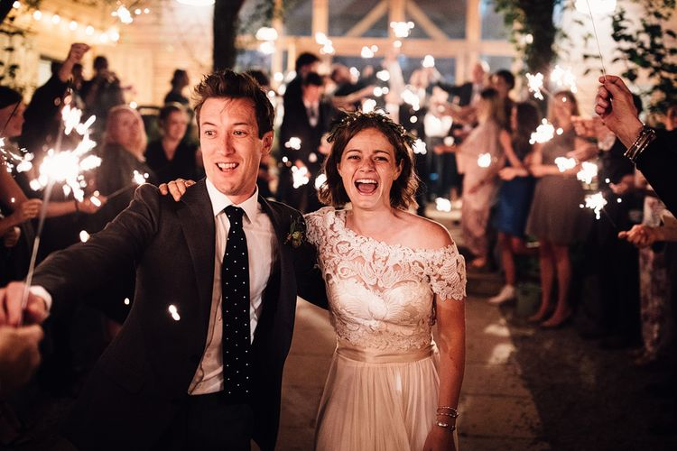 Sparkler Exit | Bride in Catherine Deane Gown | Groom in Grey Edit Suits Suit | Rustic Barn Wedding at Nancarrow Farm, Cornwall | Samuel Docker Photography