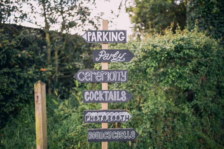 Chalkboard Wedding Signs | PapaKåta Sperry Tent at Chafford Park in Kent Countryside | Eve Dunlop Photography | Roost Film Co.