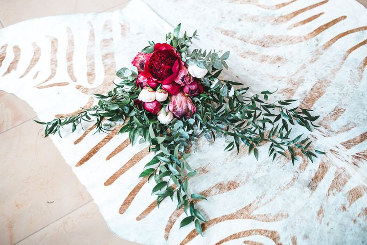 Deep Pink Peony & Protea Wedding Bouquet | PapaKåta Sperry Tent at Chafford Park in Kent Countryside | Eve Dunlop Photography | Roost Film Co.