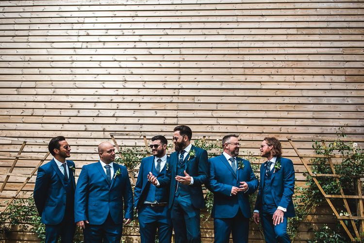 Groomsmen in Navy Suits | PapaKåta Sperry Tent at Chafford Park in Kent Countryside | Eve Dunlop Photography | Roost Film Co.