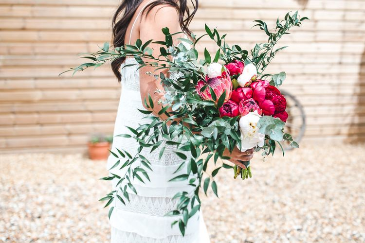 Oversized Peony & Protea Bouquet with Foliage | PapaKåta Sperry Tent at Chafford Park in Kent Countryside | Eve Dunlop Photography | Roost Film Co.