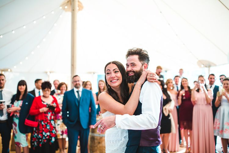 First Dance | Bride in Self Portrait Dress | Groom in Navy Suit | PapaKåta Sperry Tent at Chafford Park in Kent Countryside | Eve Dunlop Photography | Roost Film Co.