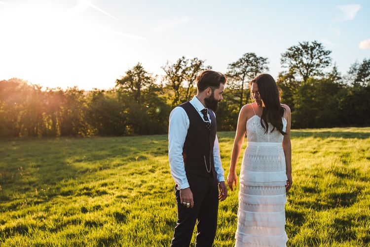 Bride in Self Portrait Dress | Groom in Navy Suit | PapaKåta Sperry Tent at Chafford Park in Kent Countryside | Eve Dunlop Photography | Roost Film Co.