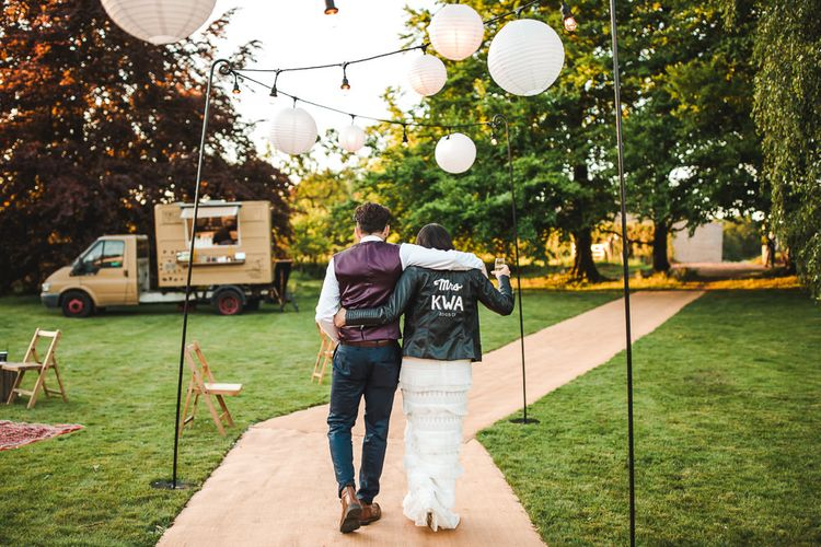 Bride in Self Portrait Dress & Personalised Leather Jacket | Groom in Navy Suit | PapaKåta Sperry Tent at Chafford Park in Kent Countryside | Eve Dunlop Photography | Roost Film Co.
