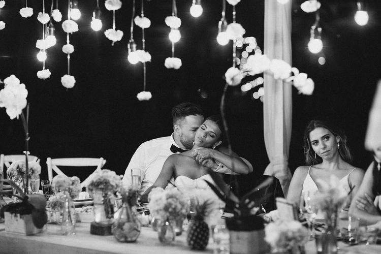 Incredible Outdoor Wedding Reception In Bali With Hanging Florals & Fairy Lights