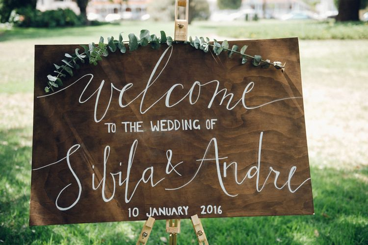 Wooden Welcome Sign with Eucalyptus Garland
