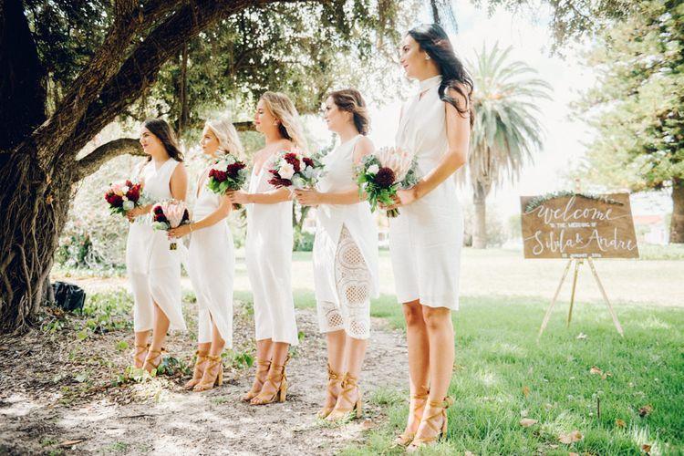 White Bridesmaid Dresses | Deep Red Protea Bouquets