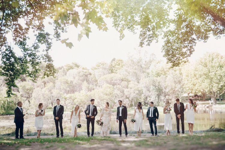Stylish Wedding Party | White Bridesmaid Dresses | Groomsmen in Tuxedos