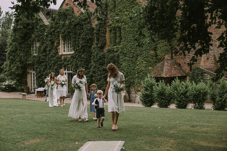 Bridesmaids Entrance in White Dresses | Blue & White Outdoor Summer Wedding at Maunsel House, Somerset | Maureen Du Preez Photography