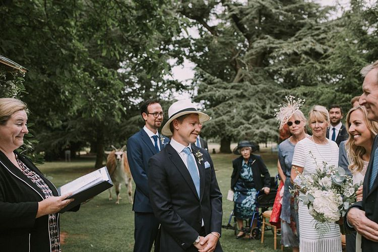 Groom in a Panama Hat at the Altar | Blue & White Outdoor Summer Wedding at Maunsel House, Somerset | Maureen Du Preez Photography