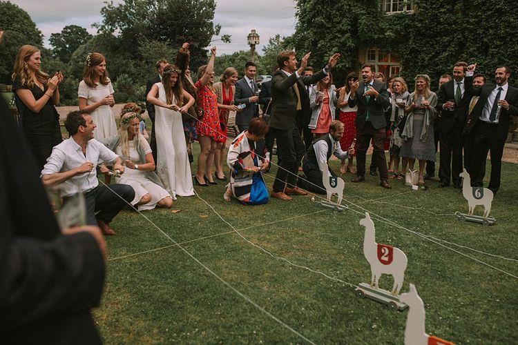 Wooden Llama Race | Blue & White Outdoor Summer Wedding at Maunsel House, Somerset | Maureen Du Preez Photography