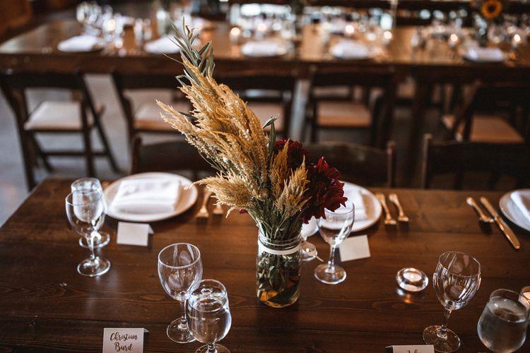 Wild Flowers in Jars Table Centrepiece | Outdoor Wedding at Claxton Farm in Weaverville, North Carolina | Benjamin Wheeler Photography