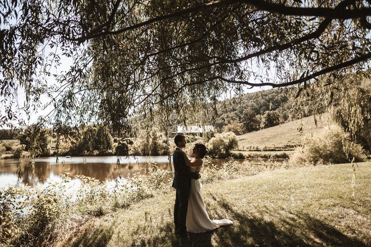 Bride in Venus Bridal Gown | Groom in Ted Baker Suit | Outdoor Wedding at Claxton Farm in Weaverville, North Carolina | Benjamin Wheeler Photography