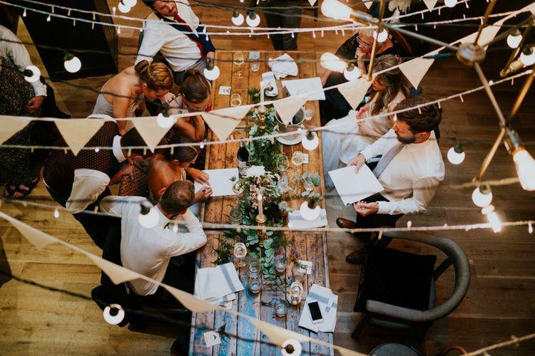 White Bunting | Greenery Table Runner & Candle Sticks | Contemporary Wedding at the Artisan Bar Clerkenwell, London | Bridgwood Wedding Photography | Long Story Short Film