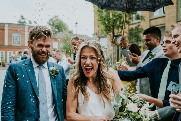 Confetti Exit | Bride in Bespoke Soon Bride Gown | Groom in Whisles Pale Blue Suit | Contemporary Wedding at the Artisan Bar Clerkenwell, London | Bridgwood Wedding Photography | Long Story Short Film