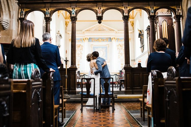 You may now kiss the Bride. St Mary's Church in Burton, The Cotswolds. Image by Through the Woods We Ran.