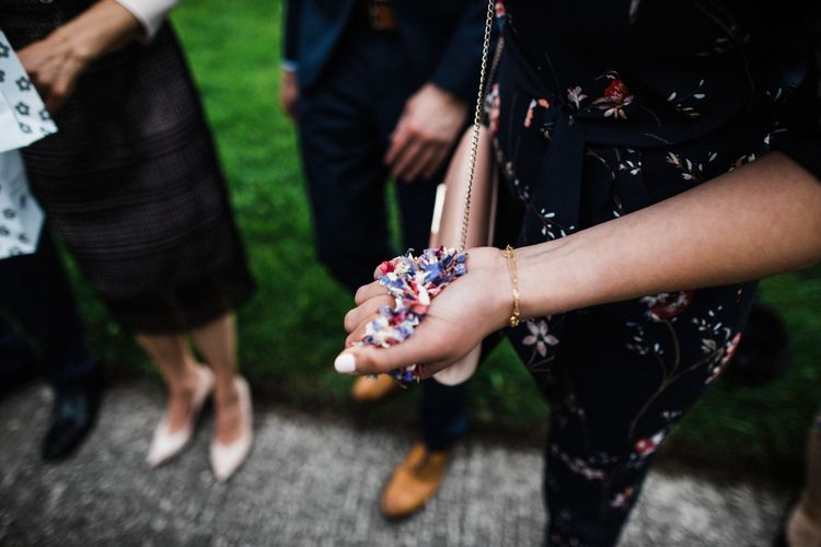 Flower Confetti for Cotswold Wedding. Image by Through the Woods We Ran.