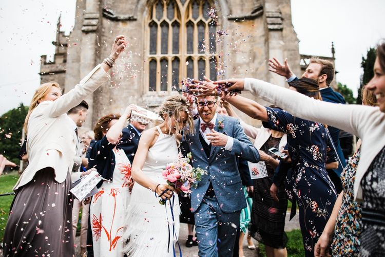 Flower Confetti outside St Mary's Church in Burton, The Cotswolds. Image by Through the Woods We Ran.