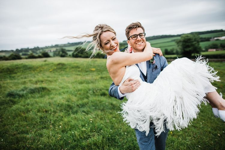 Fringed skirt by Charlie Brear looking fabulous. Couple photo shoot in The Cotswolds after wedding. Image by Through the Woods We Ran.