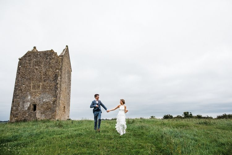 Bride in Fringed skirt by Charlie Brear looking fabulous. Couple photo shoot in The Cotswolds after wedding. Image by Through the Woods We Ran.