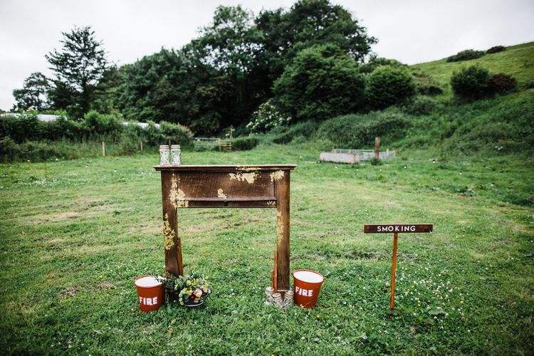 Dressing a field for a wedding. Image by Through the Woods We Ran.
