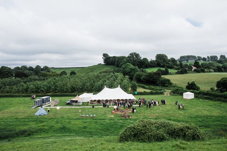 A blank Canvas wedding in the Middle of The Cotswolds. Southwest Marquees coming up trumps with this beauty. Image by Through the Woods We Ran.