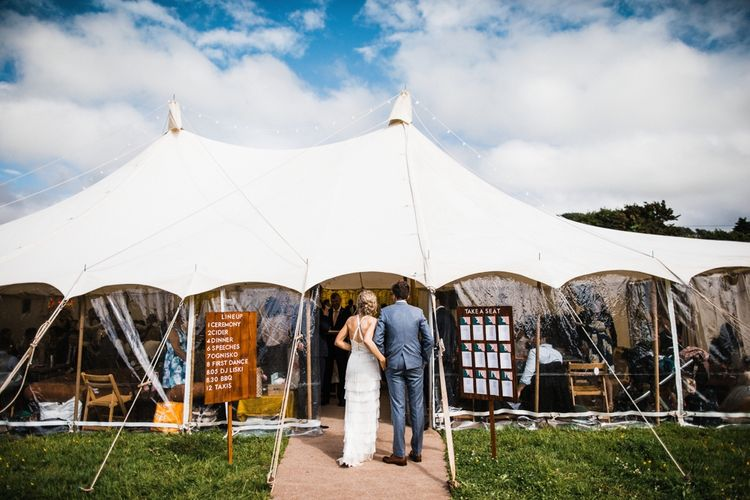 Wedding Marquee Reception Entrance. Signage and a lovely table plan. Image by Through the Woods We Ran.