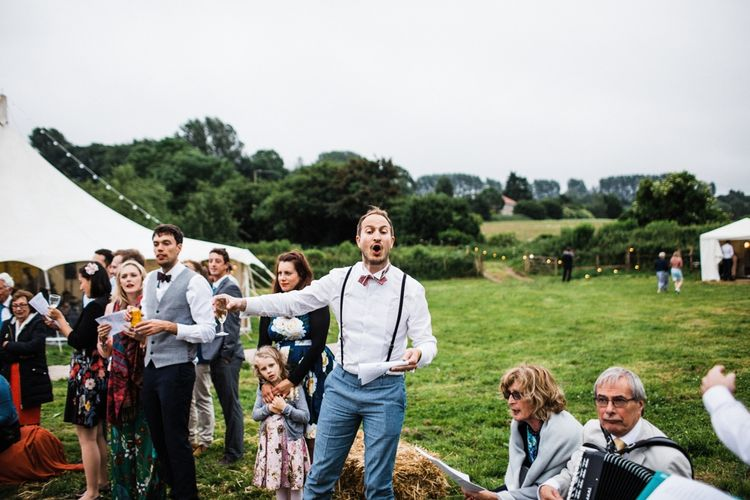 Wedding Entertainment by the guests around the bonfire. Image by Through the Woods We Ran.