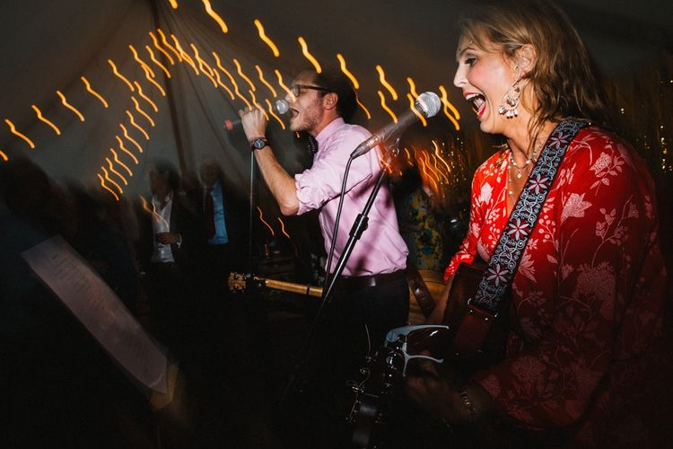 Entertainment by friends that form a band for your wedding! Amazing! Image by Through the Woods We Ran.