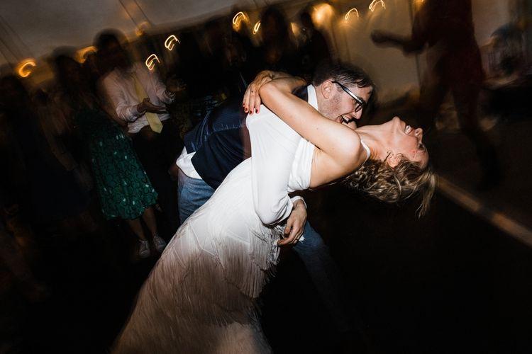 Bride and Groom Dancing. Bride wears Charlie Brears. Image by Through the Woods We Ran.